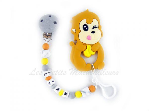 attache tétine duo et son jouet de dentition singe en silicone couleur mangue